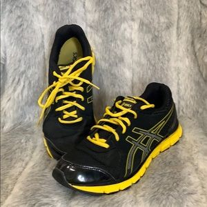 Men's Asics athletic shoes black and gold/yellow